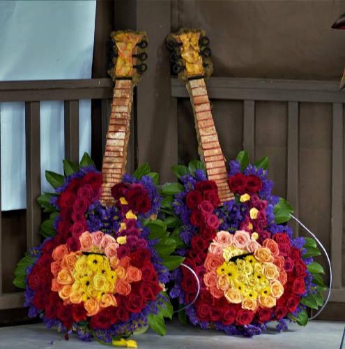 creative funeral flowers Gregg Allman guitars